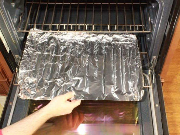 Spread aluminum foil on the bottom rack of the oven you intend to use.