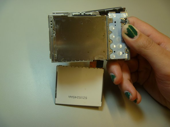 The LCD is now removed from the camera, although attached by a ribbon at the bottom of the camera.