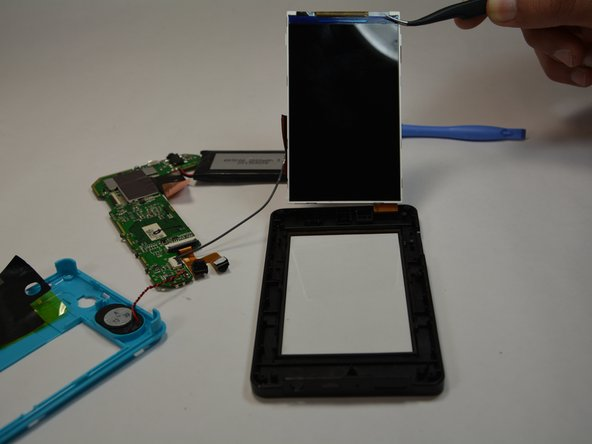 Use tweezers to remove the screen from your Kurio Toich 4S.
