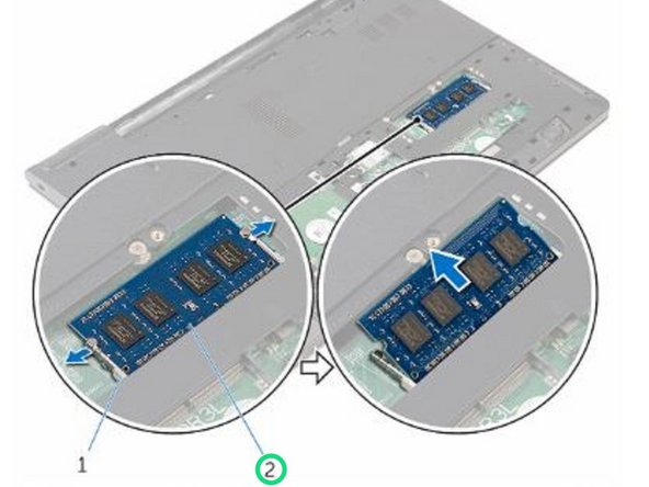Using your fingertips, pry apart the securing clips on each end of the memory-module slot until the memory module pops up.