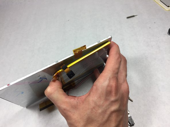Next, peel the battery off the double sided tape to remove it from the metal.