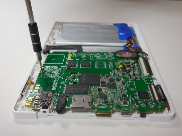 Remove the motherboard by unscrewing the four 4 mm screws along the edges of the board using a Philips 00 screwdriver.