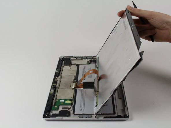 Image 1/1: Do not pull out the display as it is still attached to the motherboard.
