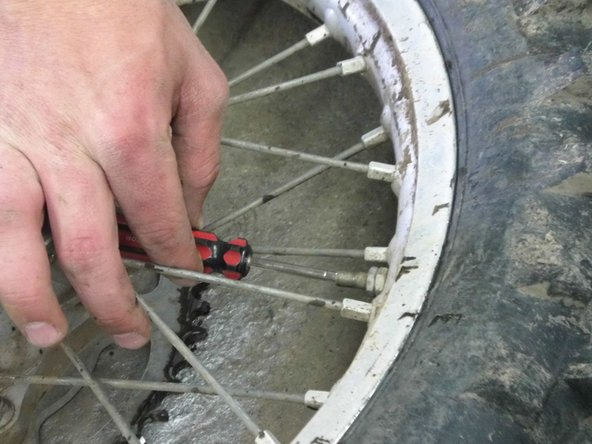 The wheel is now off. Now you should take the valve core out of the tire with  a valve core tool, and release all the air. Use a size 12mm wrench and take the nuts off the valve stem, and the bead lock. Which is the other thing in the rim with a nut on it besides the valve stem.