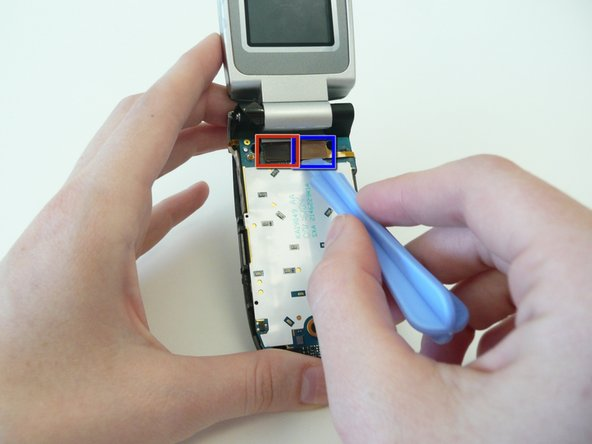Use the i Pod opening tool to remove the 2 ribbon wires (boxed in the photo) from the logic board.