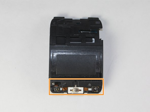 Locate the home ribbon assembly attached to the screen side of the motherboard assembly.