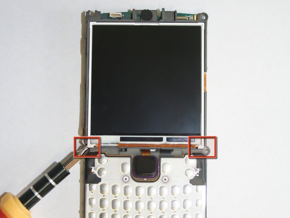 Using a 1 mm flat head screwdriver, carefully pry under the lower left and right corners of the LCD screen.