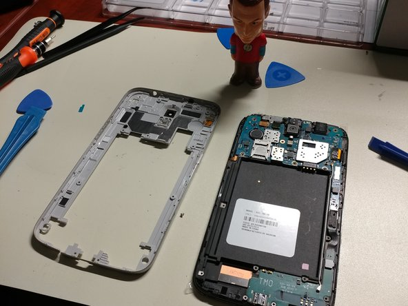 Fully remove the rear assembly frame from the main device.