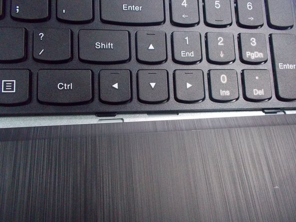 Image 1/1: Finish it by pushing down on the top of the keyboard down until you hear each part pop in.