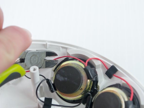 Cut the red wire (leading to the speaker you are replacing) with a pair of wire cutters.