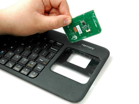 Wiggle and lift up the PCB with your thumb as you nudge the spudger up to release the PCB.