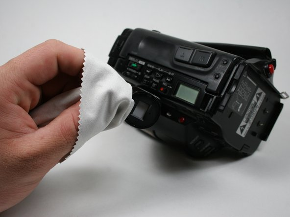 Use a cleaning cloth to wipe away residue from the viewfinder.