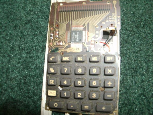 You will now see the circuit board and the buttons. Remove the buttons for the calculator.