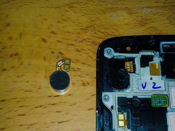 Image 3/3: Remove vibrator.