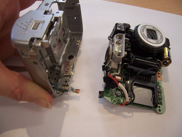 Pull the connecting strip away from the circuit board to separate it from the front casing.