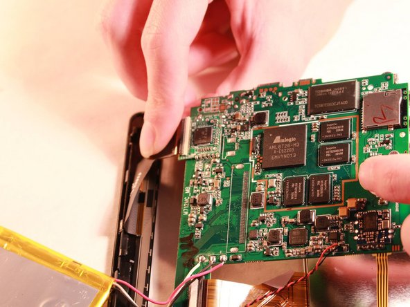 Remove the circuit board from the device by uncliping the copper flexible PCB ribbon cable from the circuit board.