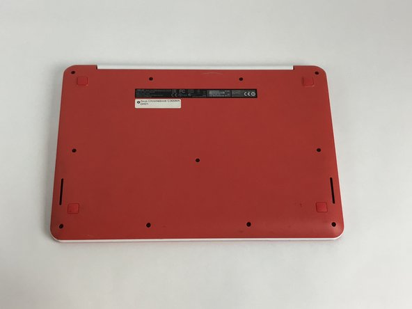 Flip the Chromebook over so the bottom of the device is facing up.