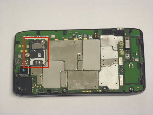 Once the Motherboard Housing is removed the complete Micro SD/SIM card reader is exposed, as indicated by the picture.