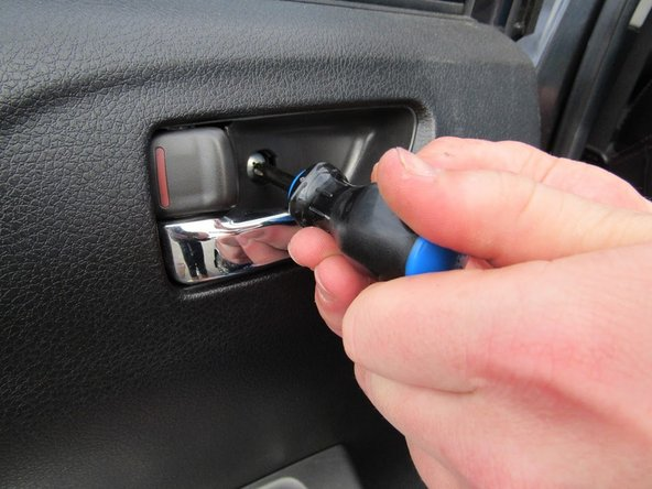 "Use the Phillips screwdriver to unscrew the 8x3/4"" Phillips screw inside the door handle."