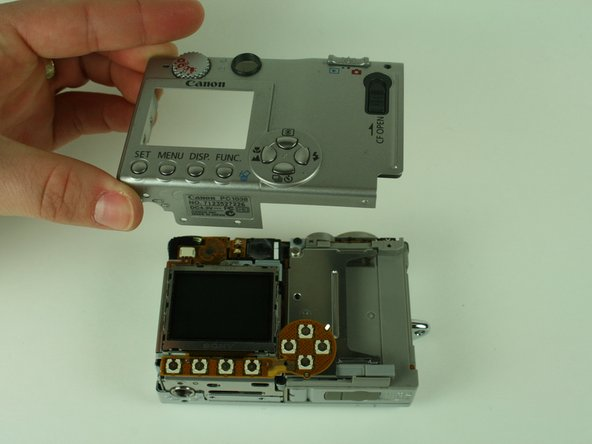 When removing the casing, do not drop the small black plastic piece. This piece sits in a small gap above the lens, to the left of the flash, and underneath the camera case.