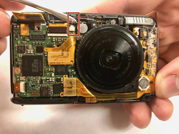 Carefully insert a metal spudger under the two clusters of wires that are plugged into the small chip on the face of the camera.