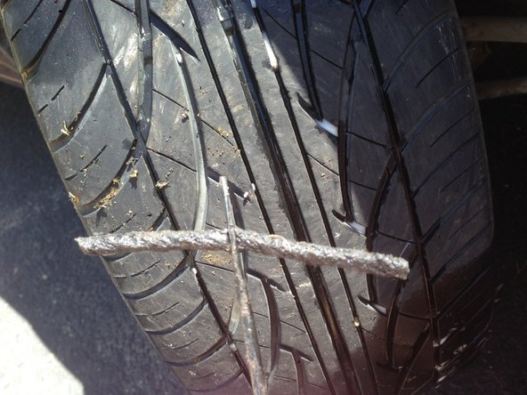 Image 1/1: Prepare your tire plug by feeding it through the eye of the insertion needle before pulling any objects from the tire that maybe causing leaks.