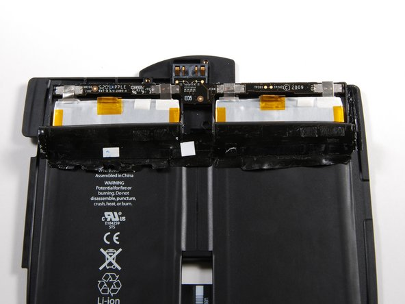 The third shot shows the other side of the battery board, which is stamped with Compeq.