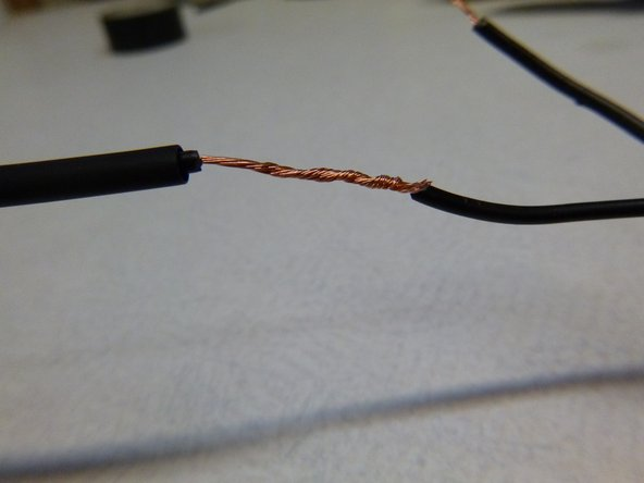 Overlay with the corresponding wire (Step 1), and twist together, but not before sliding on the HeatShrink.