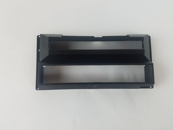 Carefully lift the cartridge door case and set aside.