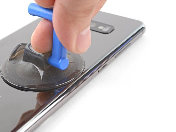Heat an iOpener and apply it to the same edge of the phone for two minutes.