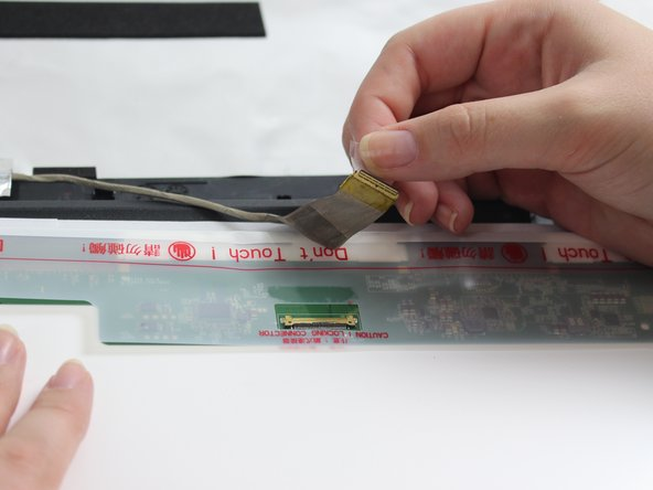 To remove the ZIF use your finger to flip up the top cover and gently pull the cable out.