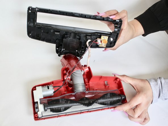 Using a firm grip, pull the two halves of the vacuum head away from each other until they are completely separated