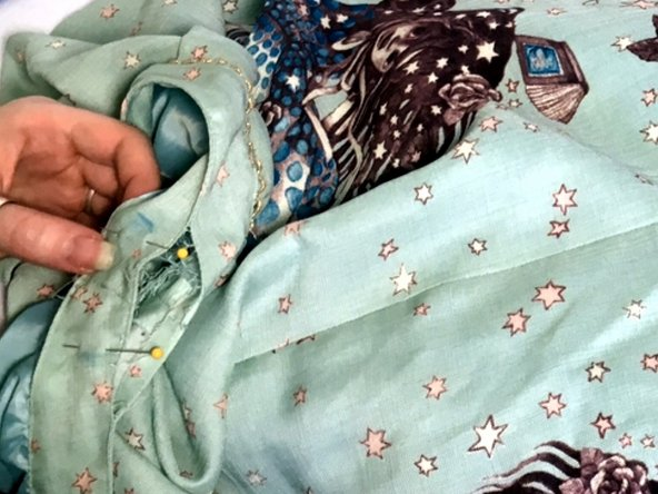 Seam rip the top of the waistband, about an inch past your measurement on either side.