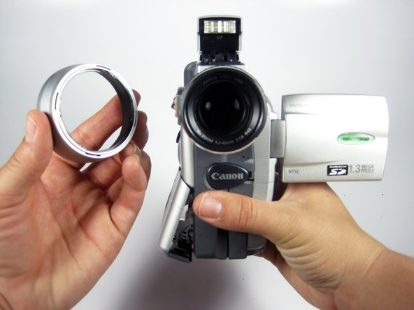 To remove the camcorder lens hood, twist the hood to counterclockwise and it will come loose, then pull towards you.