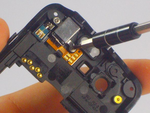 After removing the screws, carefully remove the audio port from the mother board.