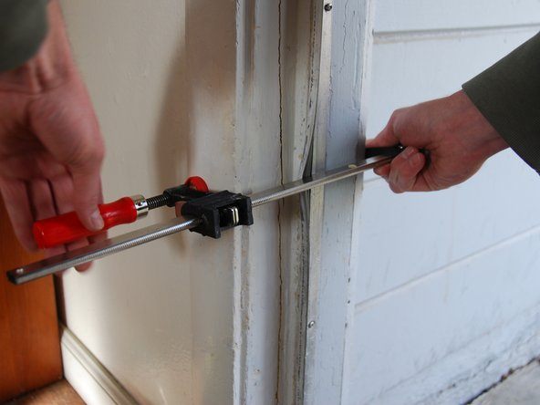 Attach the clamp onto the cracked door frame.