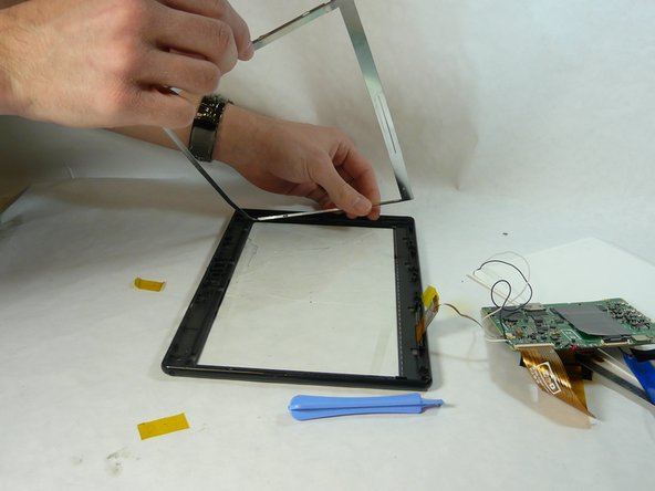 Using the plastic pry tool remove metal frame.