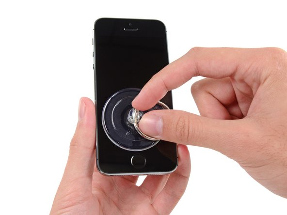 Image 1/1: Press a suction cup onto the screen, just above the home button.