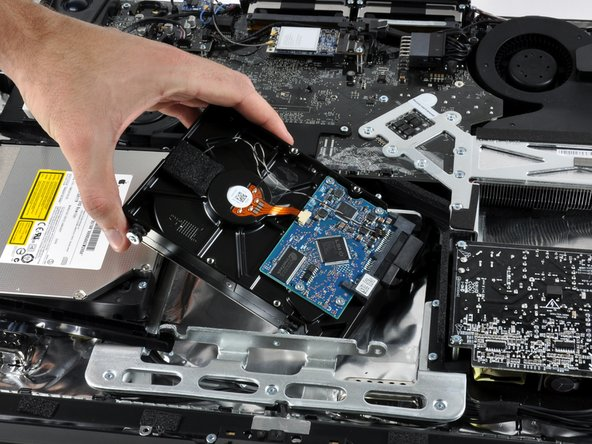 Removing the desktop 320GB SATA hard drive.