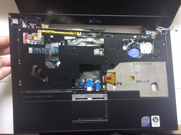 Lift the keyboard panel to separate the component from the rest of the device.