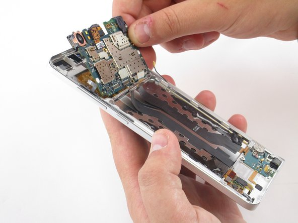 Image 2/2: Be sure that the Dual SIM card and tray has been removed.