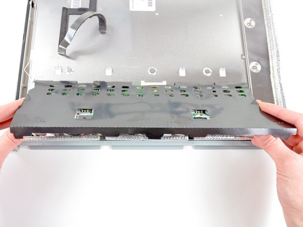 Image 1/2: When reinstalling the inverter board, be sure to push the board under the two tabs nearest the center of the LCD before lowering it down into place.