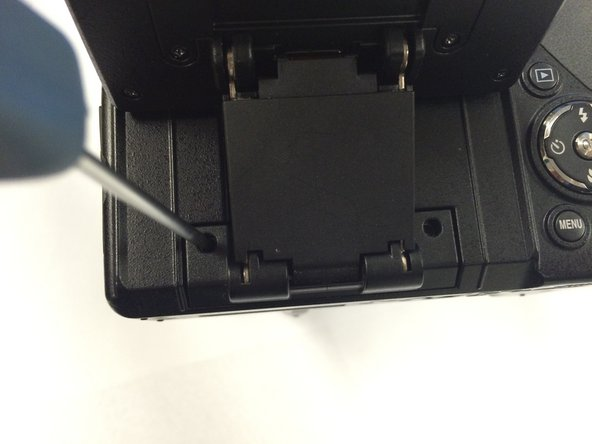 Remove the two screws hidden underneath the display panel.