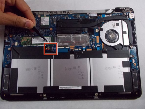 Next, lift up the battery connector from the laptop in the upper left side of the battery, using tweezers or spudger.