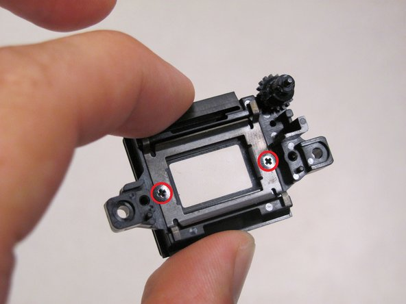 At last, to remove the glass panel unfasten the two 3.6 mm, black screws from the outer piece . When separating the glass panel, make sure not to separate the small, rubber piece attached to the panel, from the outer piece. Now, you can replace the inner eyepiece.