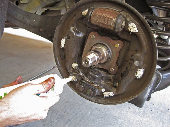 Drum brakes are notoriously noisy, so don't be afraid to put plenty of grease on the backing plate.