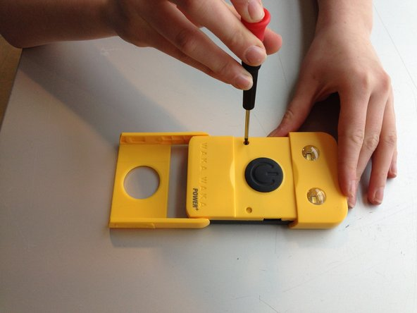 First you remove the two yellow rubbers using your nail or the screwdriver. Than use the Phillips screwdriver to remove the two screws.