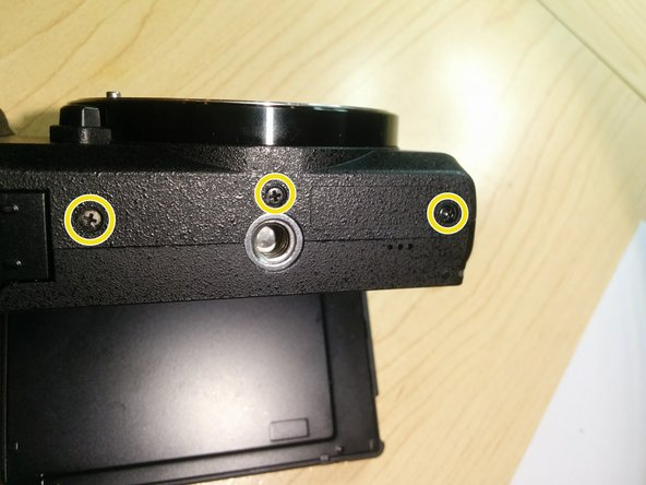 Image 2/2: Remove 3 more screws from the bottom of the camera