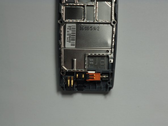 With the logic board and LCD unit removed, gently pry out the charging port.