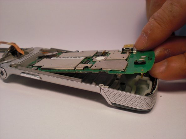Lift up the logic board from the bottom flip with your fingers.